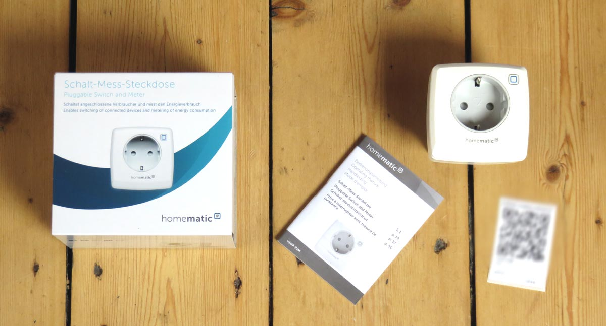 Homematic IP -Schalt-Mess-Steckdose mit Verpackung und Inhalt